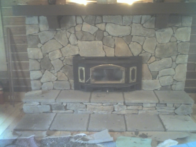 After photo of stone fireplace over brick
